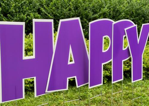 happy yard sign in purple